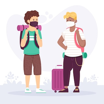 Turisti che indossano maschere facciali