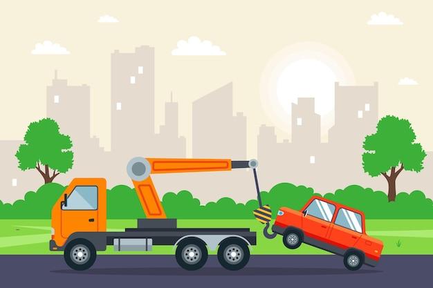 도시에서 자동차를 견인하는 견인 트럭