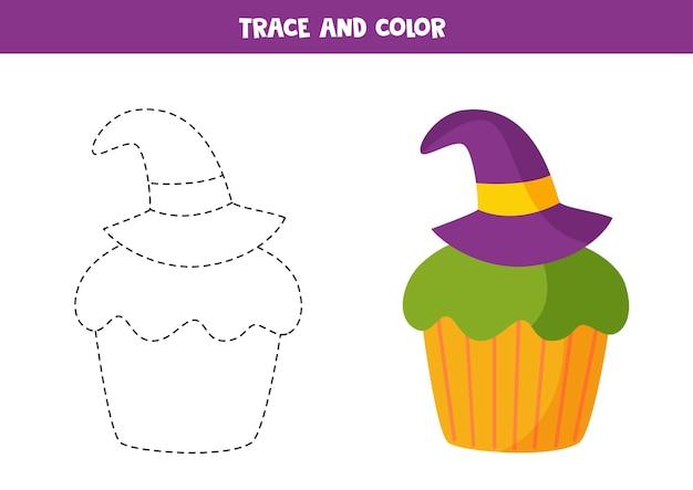 魔法使いの帽子で飾られたトレースと色のかわいいハロウィーンのカップケーキ。教育用ぬりえ。