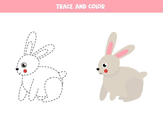 かわいいウサギをトレースして色付けします。子供のための教育ゲーム。ライティングとカラーリングの練習。