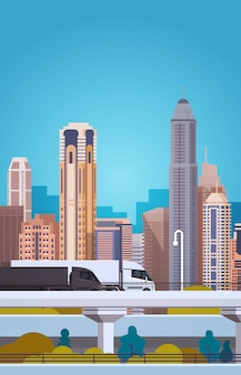 Track trailers transportation on highway over city background cargo delivery concept