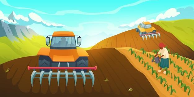 労働者の世話と植物の伝統的な水やりで田舎の山の風景に畑を耕すトラクター...