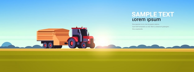 Tractor with trailer heavy machinery working in field smart farming modern technology organization of harvesting concept sunset landscape copy space