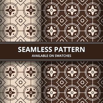 伝統的なバティックのシームレスなパターン背景の古典的な壁紙。エレガントな幾何学的形状。茶色の豪華な民族的背景