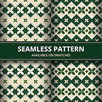 伝統的なバティックのシームレスなパターン背景の古典的な壁紙。エレガントな幾何学的形状。緑の色で豪華な民族的背景