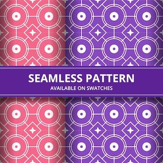 伝統的なバティックのシームレスなパターン背景の古典的な壁紙。エレガントな幾何学的形状。ピンクと紫の色の豪華な民族的背景