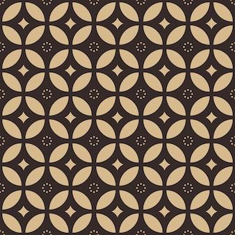 幾何学的形状のスタイルで伝統的なバティックのシームレスなパターン背景壁紙
