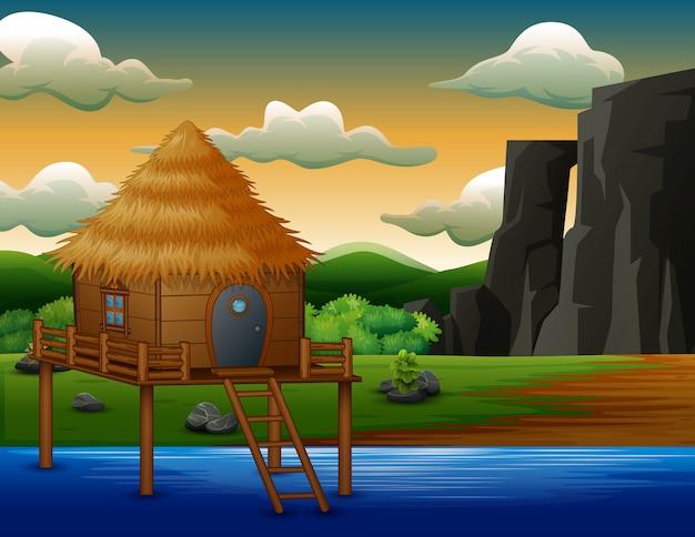 강 위의 전통 오두막 집