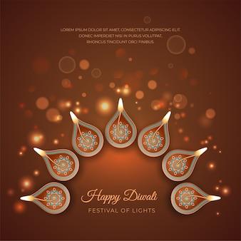 燃えるディヤランプと光の効果を持つ伝統的なディワリ祭の背景