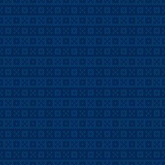 Традиционный вязаный свитер с узором fair isle. абстрактный клетчатый вектор бесшовный фон с оттенками синего цвета. имитация текстуры шерсти.