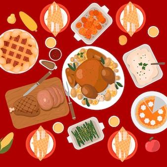Традиционный семейный ужин в день благодарения с жареной индейкой, ветчиной, сладким картофелем, кукурузой, гарнирами, пирожными, печеньем. вид сверху.