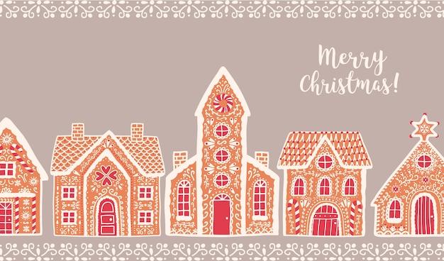 伝統的なジンジャーブレッドハウスとメリークリスマスのレタリング
