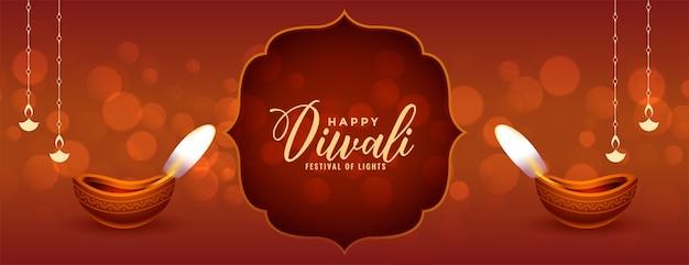 Banner di diwali felice tradizionale con diya realistico