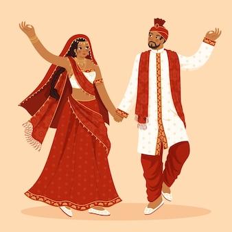 女と男と伝統的なインドの服