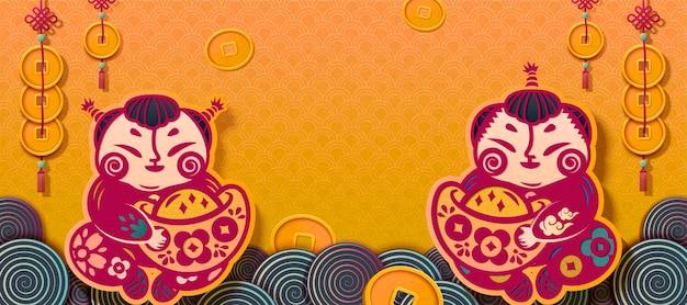 黄色のバナーに金のインゴットを保持している伝統的なペーパーアートの子供たち