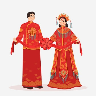 Traditional red clothes with woman and man