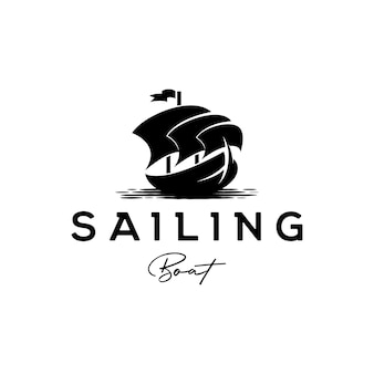 Traditional sailing yacht, boat, ship silhouette logo design vector