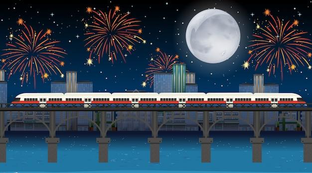 축하 불꽃 놀이 장면으로 강을 건너는 기차