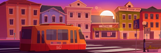 Tram riding on retro city street at sunset time