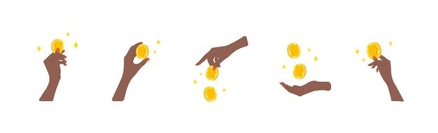 돈을 이체합니다. 황금 동전을 주는 아프리카 여성의 손.