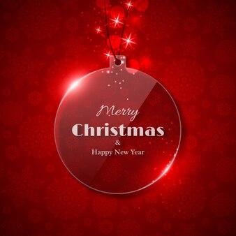 輝く光、赤い背景、スノーフレークパターンを持つ透明なガラスクリスマスボール。メリークリスマスと新年あけましておめでとうございますテキスト。