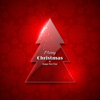 輝く光、赤い背景、スノーフレークパターンを持つ透明なガラスのクリスマスツリー。メリークリスマスと新年あけましておめでとうございますテキスト。