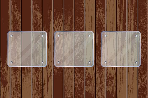 Прозрачные стеклянные пластины на деревянном текстурированном фоне