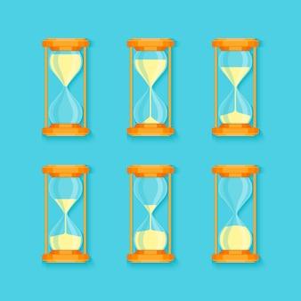 Набор прозрачных песочных часов на синем