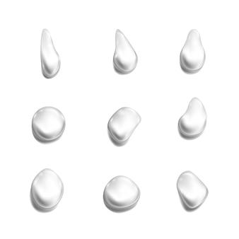 透明な滴のセット。白い背景の上の図