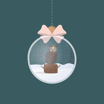 イラストの中にフクロウと透明な銀のクリスマスボール