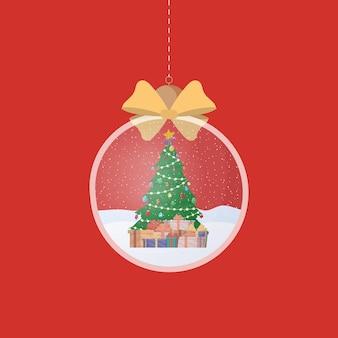 ギフトとクリスマスツリーが入った透明なシルバーのクリスマスボール。