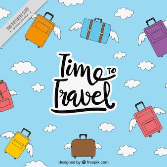 Travel background of suitcases with wings