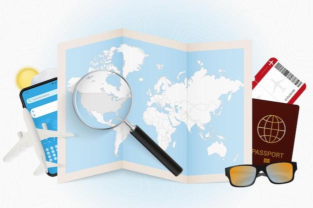 여행 장비와 돋보기가 있는 세계 지도가 있는 여행 목적지 미국 관광 모형