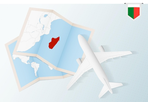 Travel to madagascar, top view airplane with map and flag of madagascar.
