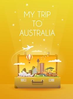 オーストラリアへ旅行します。ランドマークのあるオープンスーツケース。
