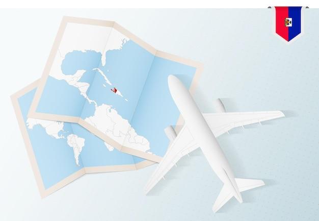 Путешествие в гаити, самолет вид сверху с картой и флагом гаити.