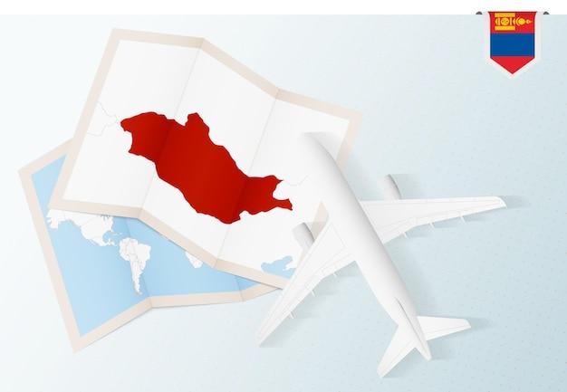 モンゴルへの旅行、モンゴルの地図と旗のある平面図の飛行機。