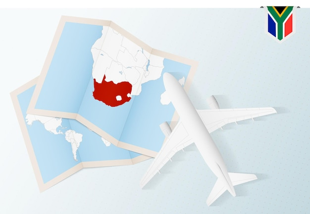 남아프리카 공화국 여행,지도와 남아프리카 공화국의 국기가있는 탑 뷰 비행기. 프리미엄 벡터