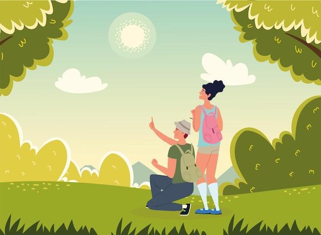 숲 필드 풍경에 여행자 커플