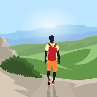 Traveler man silhouette hiking mountain top valley rear view