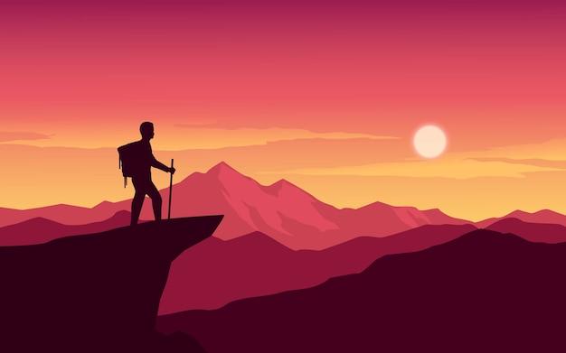 Путешественник, стоящий с рюкзаком на вершине горы