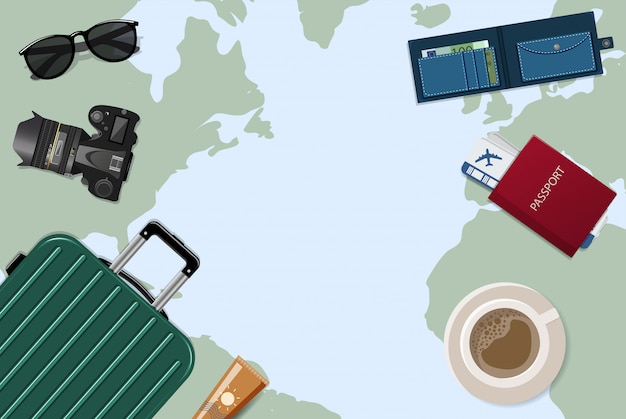 Travelers desktop with a detailed map of the world, on which is located a suitcase, baggage, air ticket, camera, passport, glasses. travel and vacation concept