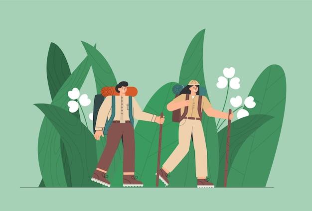 정글에서 여행자. 사람, 남자와 여자는 큰 녹색 잎을 즐깁니다.