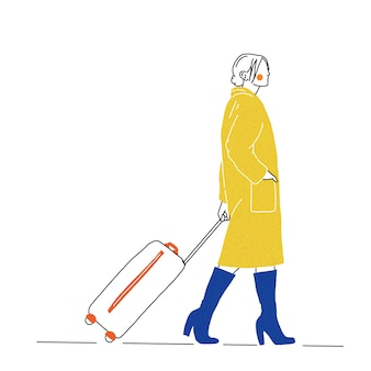 A traveling woman carrying a suitcase