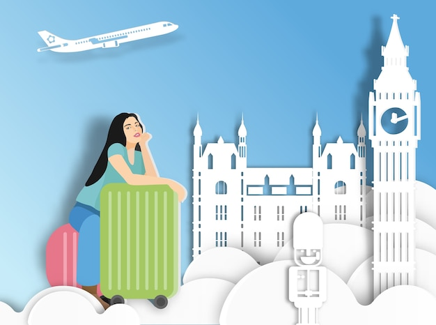 ロンドンの背景にスーツケースを持つ旅行の女性