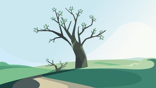 春の丘の上の木。美しい自然の風景。
