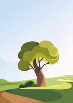 Дерево на холме в летний сезон. природный пейзаж в вертикальной ориентации.