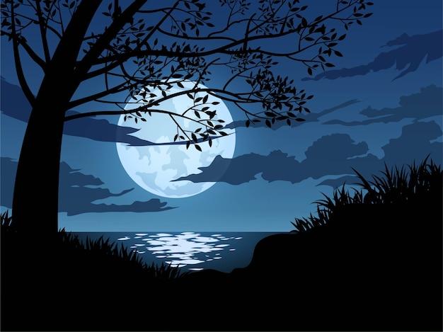 月明かりの下で木のシルエット