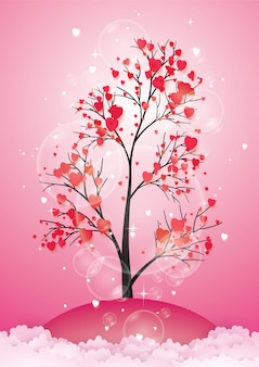 Tree with paper leaves and hanging hearts.
