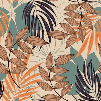 Trend abstract seamless pattern with colorful tropical leaves and plants on beige